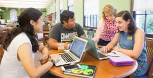 Librarian works with 3 students